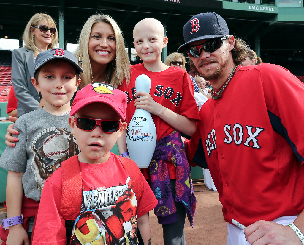 Boston Red Sox pitcher Clay Buchholz, right, and his wife Lindsay, third from left, welcome children from Christopher's Haven to Fenway Park in Boston for the game against the Texas Rangers on Wednesday, June 5, 2013.(Brita Meng Outzen/Boston Red Sox)
